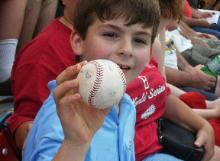 Boy sitting three seats over from us, catches a Manny Ramrez ball.
